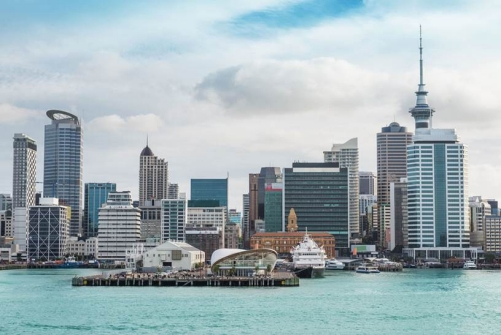 View of the Auckland waterfront from the harbour, including the Cloud, the Ferry Building and the Sky Tower.