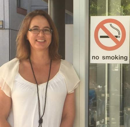 """Natalie Walker with """"no smoking"""" sign"""