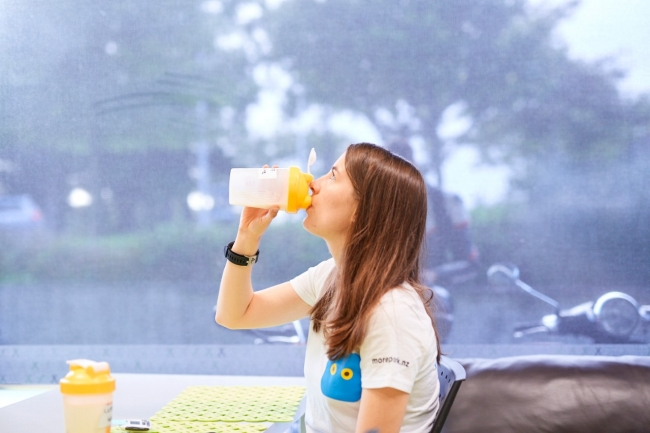 "A study participant takes her milk ""challenge"""