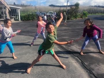 Oturu School pupils dancing in the playground