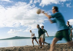 Students playing vollyball on Mission Beach, Auckland