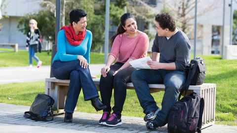 Students sitting on a bench.